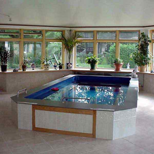 Neuendorf indoor lap pool gimme shelter construction for Indoor swimming pool construction